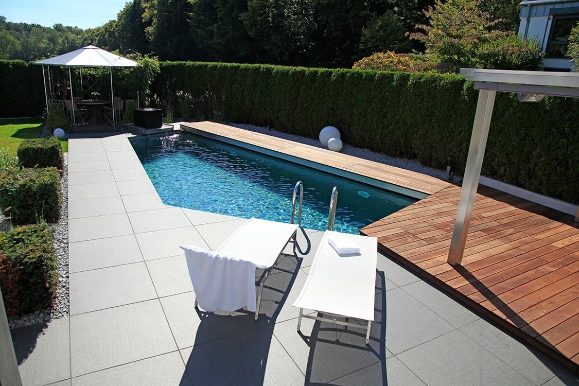 biotop bio pool mit einer mischung aus edelstahl und naturstein. Black Bedroom Furniture Sets. Home Design Ideas